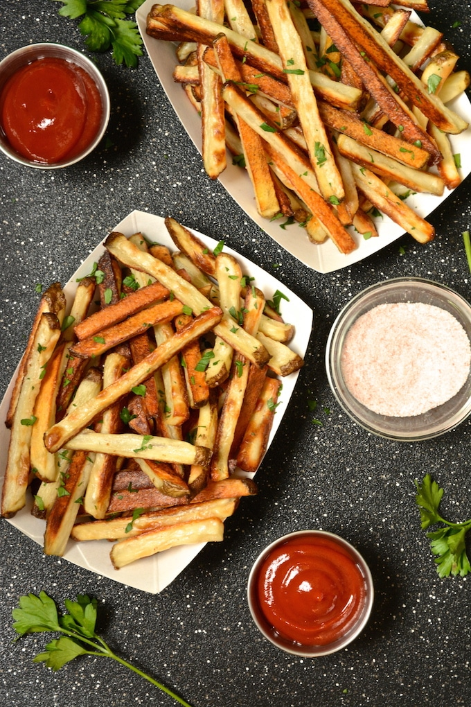 These crispy baked seasoned fries are tender on the inside and lightly crispy on the outside. They make a great side to any vegan burger. Since the fries are baked, not fried, you can indulge in a healthier option!