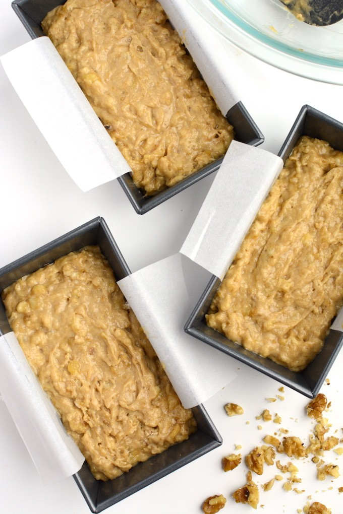 Vegan banana bread batter in mini loaf pans.