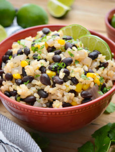 A bowl of black beans and lime rice.