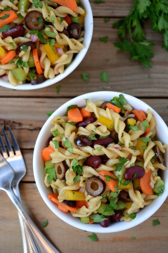 "A healthier, vegan Italian Pasta Salad prepared with a sweet and tangy, homemade balsamic vinaigrette. A ""must have"" for any summertime picnic or gathering. It's quick, easy to make and ready in under 30 minutes! Plus, swapping out the noodles instantly makes this gluten-free!"
