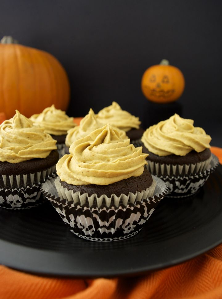 Pumpkin Frosted Chocolate Cupcakes with Bat Bites are a healthier, vegan holiday-inspired dessert. The pumpkin spiced frosting is made from whipped coconut cream and real pumpkin purée. And the cupcakes are rich and chocolatey with the addition of chocolate chips. Top them with a thin mint bat cookie for a spooky fun halloween treat!