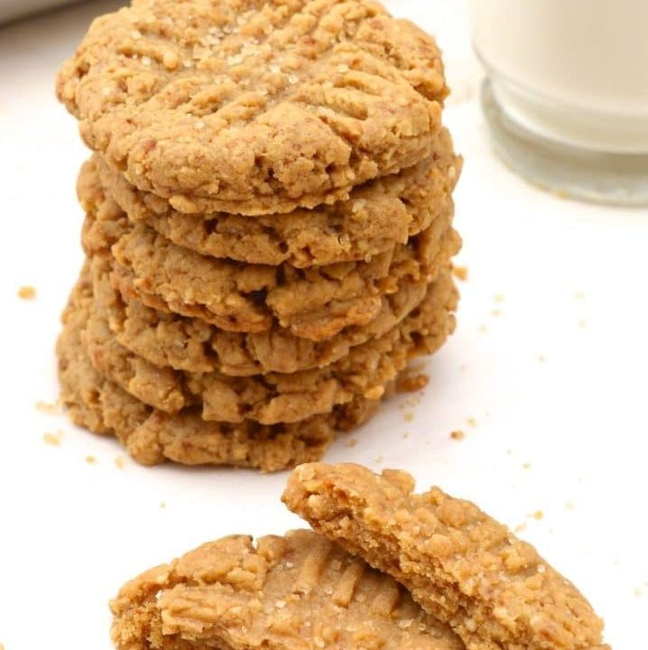 Vegan Peanut Butter Cookies are great for holiday baking! These soft irresistible cookies are bursting with peanut butter flavor. A classic cookie that will disappear fast! Plus they're egg free, dairy free, refined-sugar free and made with fresh ground peanut butter, which makes them a healthier choice! Video included!