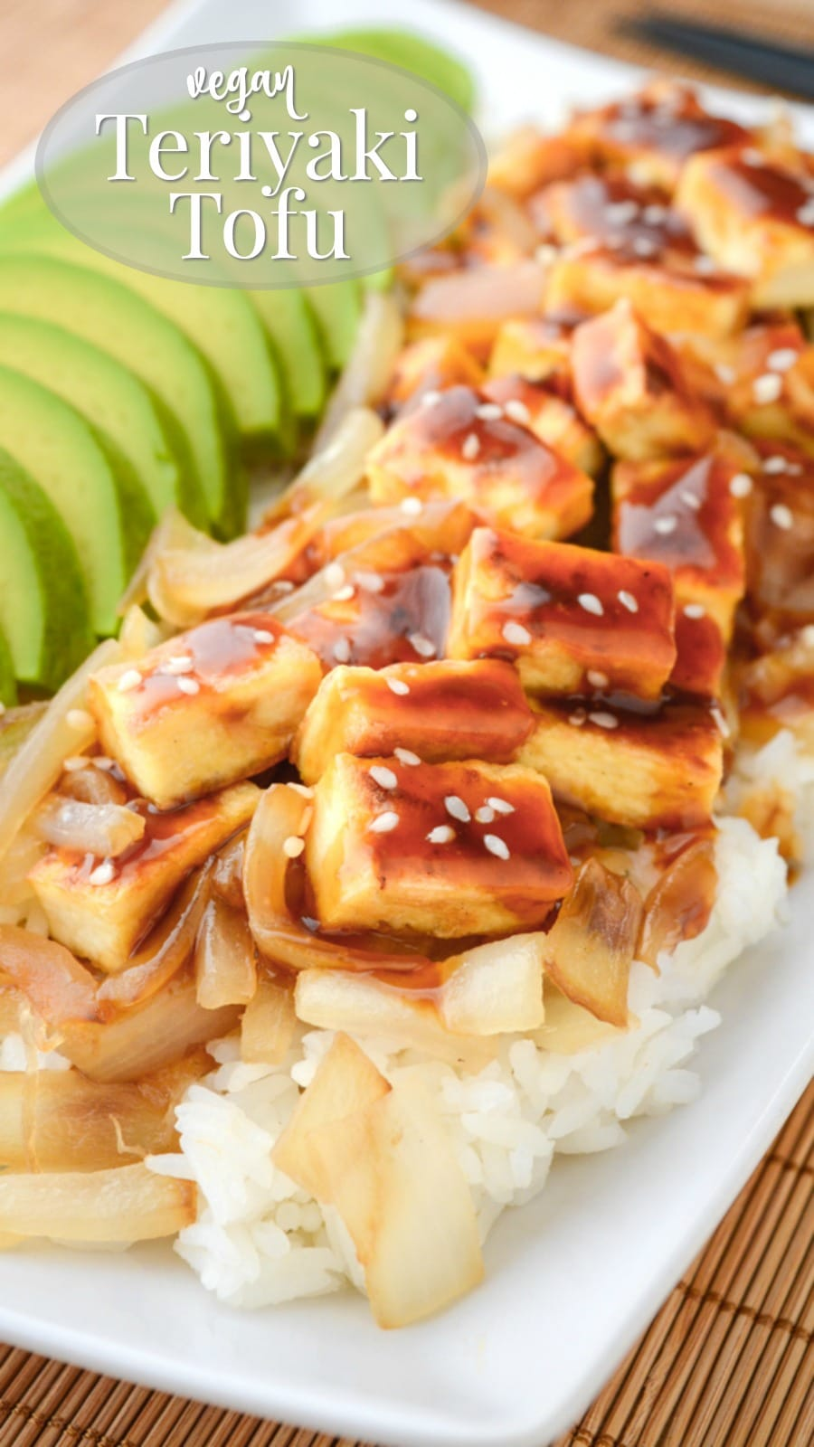Teriyaki tofu with rice and caramelized onions served with sliced avocado.
