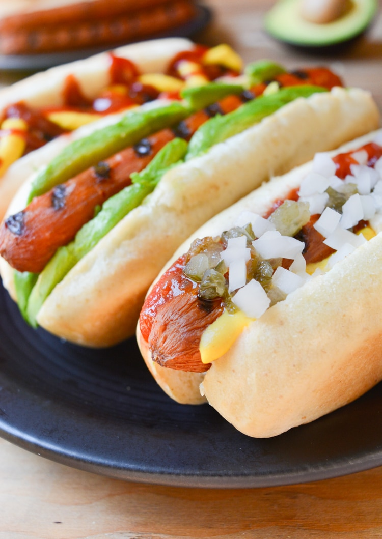 Vegan Carrot Dogs in a bun with toppings.