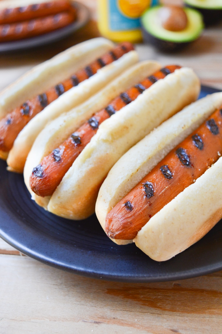 Vegan Carrot Dogs with grill lines in a bun. close up angle.