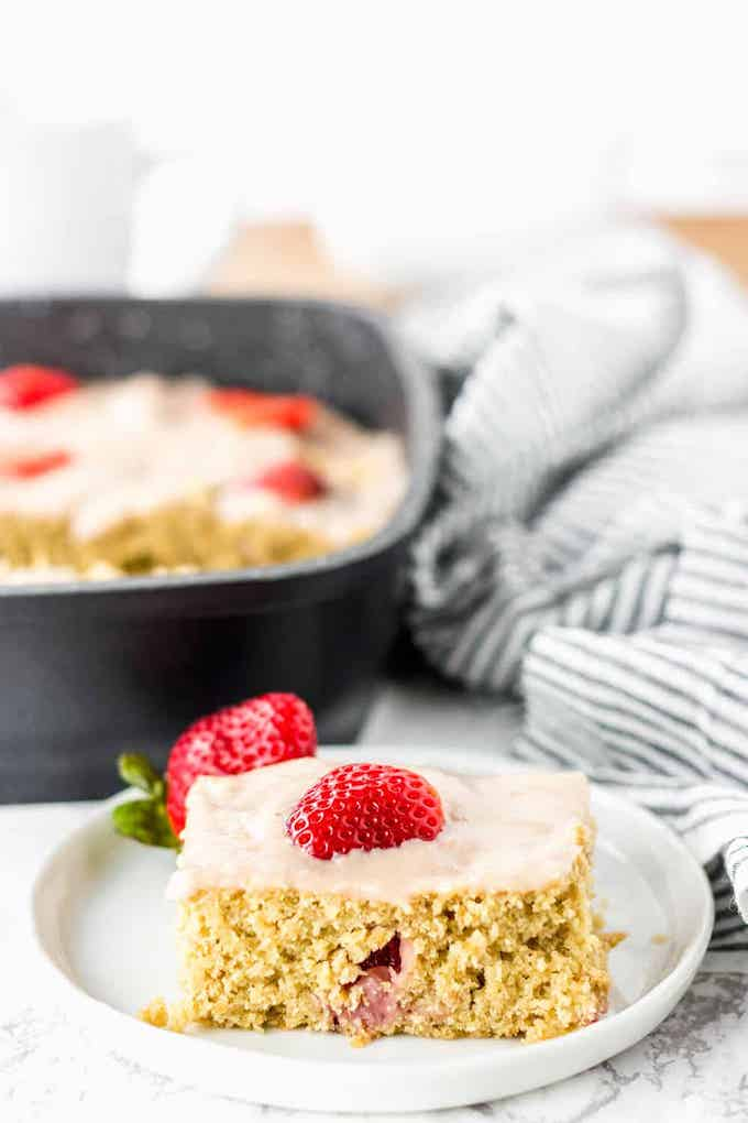 a slice of vegan strawberry breakfast cake.