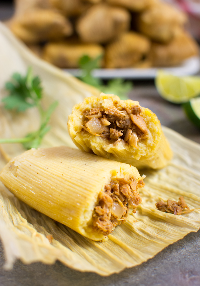 Jackfruit vegan tamale cut in half on a corn husk.