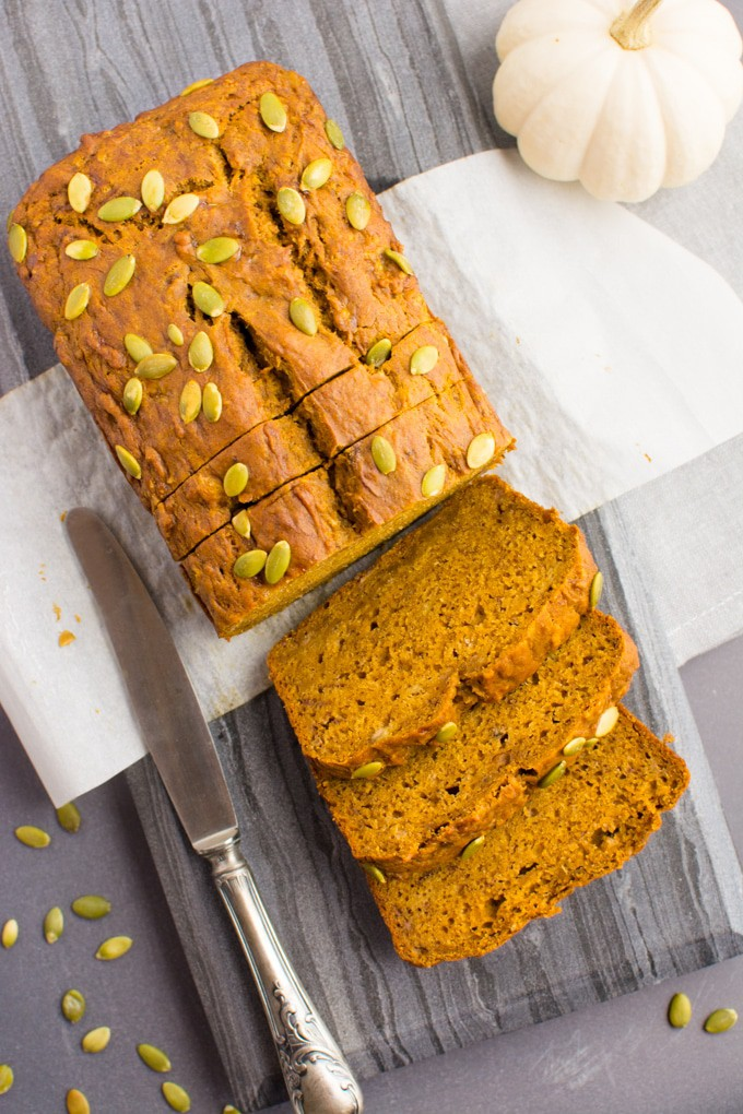 Vegan Pumpkin Banana bread topped with pumpkin seeds.