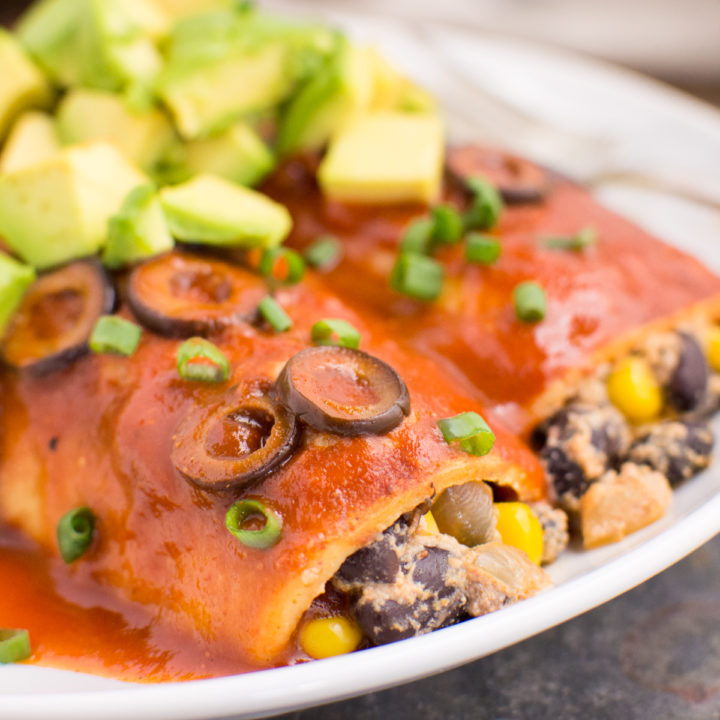 Black bean enchiladas topped with freshly diced avocado.