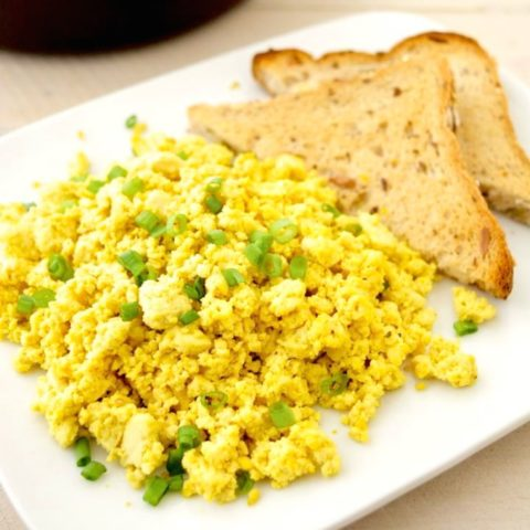 Plated tofu scramble with toast.