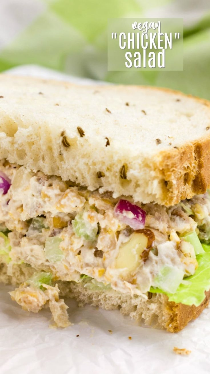 Vegan chicken salad is perfect for school and work lunches.  This cooling salad is loaded with shredded jackfruit, protein-packed chickpeas, fresh veggies, and homemade seasoned mayo. For a quick vegan snack or easy dinner, enjoy it on a sandwich, spread on crackers, wrapped in lettuce leaves, or straight out of the bowl! Vegan chicken salad is obsession-worthy!  #veganrecipes #summersalad #meatless #veganfood #chickpeas #jackfruit #oilfree