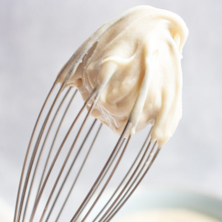 cashew frosting whipped on a whisk.