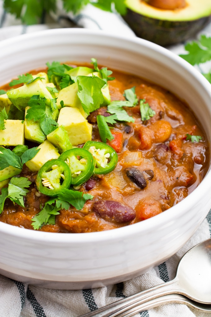 The best vegan chili topped with avocado, cilantro and jalapeño.