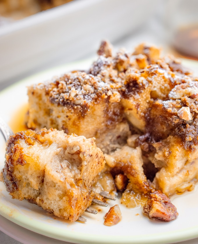 A bite of vegan french toast casserole on a fork.