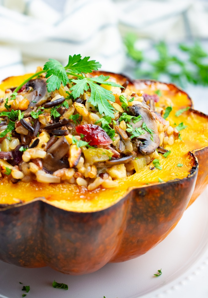 Roasted acorn squash stuffed with wild rice and mushrooms.