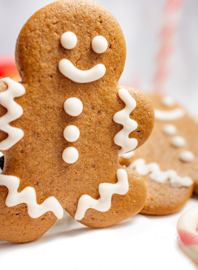 A decorated vegan gingerbread cookie standing up.