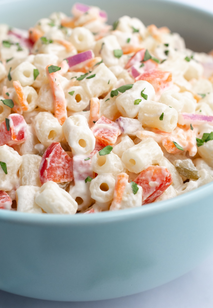 Vegan macaroni salad with bell peppers, onion, carrots ,relish, and parsley.