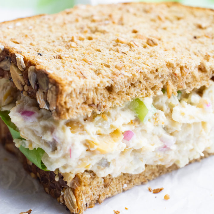 Vegan tuna salad sandwich on wheat bread.