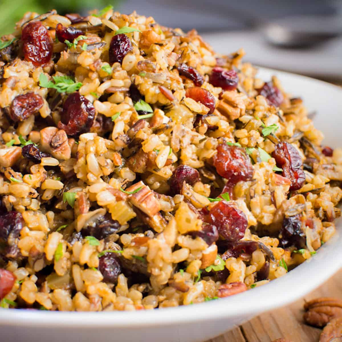 A serving bowl fill with Gluten-Free Wild Rice Stuffing.